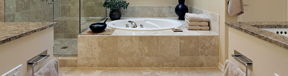 Stone used in a bathroon as countertops, tub and shower surrounds, and flooring.
